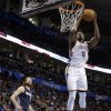 Oklahoma City\'s Serge Ibaka (9) dunks in front of Charlotte\'s Josh McRoberts (11) during the NBA basketball game between the Oklahoma City Thunder and the Charlotte Bobcats at the Chesapeake Energy Arena, Sunday, March 2, 2014. Photo by Sarah Phipps, The Oklahoman
