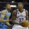 Photo - Memphis Grizzlies' Ed Davis (32) looks for room around New Orleans Hornets' Anthony Davis (23) during the first half of an NBA basketball game in Memphis, Tenn., Saturday, March 9, 2013. (AP Photo/Danny Johnston)