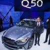 Photo - Infiniti Chief Creative Officer Shiro Nakamura stands next to the newly unveiled Q50 sedan, at the North American International Auto Show, Monday, Jan. 14, 2013, in Detroit, Mich. (AP Photo/Tony Ding)