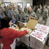 A Blue Star Mother serves pizza to soldiers who are awaiting the arrival of flights to take them home. A US Army spokesman from Ft. Sill said nearly 1,000 troops boarded buses for the trip to Will Rogers World Airport in Oklahoma City to catch flights home for the Christmas holidays. Buses filled with soldiers began arriving at the airport after midnight Wednesday and into the pre-dawn hours on Thursday, Dec. 19, 2013. While waiting to board flights, the troops were treated to food and warm beverages at the YMCA Military Welcome Center at the airport. Soldiers were offered pizza, doughnuts and sub sandwiches, with hot coffee or chocolate, and bottled water. Friendly faces from local organizations were there to greet them and assist them. Volunteers represented several groups, including Blue Star Mothers, Patriot Guard Riders and an organization consisting of Purple Heart recipients. Photo by Jim Beckel, The Oklahoman
