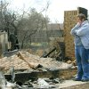 Shelly Evans looks at the remains of her grandmother\'s home at 208 Oine Tree road that was destroyed in a wildfire in Choctaw, Oklahoma April 10, 2009. Photo by Steve Gooch, The Oklahoman