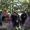 In this photo taken on Sunday, May 11, 2014, people mourn outside a police station where a few people were killed during fighting between government forces and insurgents on Friday, May 9 in Mariupol, eastern Ukraine. The insurgents in the east have seized government buildings and clashed with government troops and police over the past month. More than 30 people have been reported killed since Ukrainian forces began trying to retake some eastern cities from the insurgents. (AP Photo/Manu Brabo)