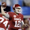 Oklahoma\'s Landry Jones (12) passes the ball during the college football Cotton Bowl game between the University of Oklahoma Sooners (OU) and Texas A&M University Aggies (TXAM) at Cowboy\'s Stadium on Friday Jan. 4, 2013, in Arlington, Tx. Photo by Chris Landsberger, The Oklahoman