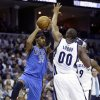 Dallas Mavericks\' O.J. Mayo (32) passes the ball over Memphis Grizzlies\' Darrell Arthur (00) during the first half of an NBA basketball game in Memphis, Tenn., Friday, Dec. 21, 2012. (AP Photo/Danny Johnston)