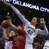 Baylo\'s Brittney Griner (42) guards Louisville\'s Monique Reid (33) as she shoots during college basketball game between Baylor University and the Louisville at the Oklahoma City Regional for the NCAA women\'s college basketball tournament at Chesapeake Energy Arena in Oklahoma City, Sunday, March 31, 2013. Photo by Sarah Phipps, The Oklahoman