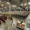 Photo - File-In this  Monday, Nov. 16, 2009 file photo, a view inside the 800,000 sq. ft. Amazon.com distribution and fulfillment center warehouse in Goodyear, Ariz. Amazon.com Inc. says it is adding 7,000 jobs in 13 states, beefing up staff at the warehouses where it fills orders, and in its customer service division. The company says it will add 5,000 full-time jobs at its U.S. distribution centers, which currently employ about 20,000 workers who pack and ship customer orders. (AP Photo/Ross D. Franklin, File)