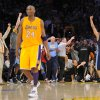 Photo -   Denver Nuggets guard Andre Miller, right, celebrates as Los Angeles Lakers guard Kobe Bryant walks off the court after time ran out in Game 5 of an NBA first-round playoff basketball game, Tuesday, May 8, 2012, in Los Angeles. The Nuggets won 102-99. (AP Photo/Mark J. Terrill)