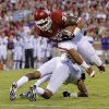 Oklahoma\'s Trey Millard (33) leaps over a TCU defender during the college football game between the University of Oklahoma Sooners (OU) and the Texas Christian University Horned Frogs (TCU) at the Gaylord Family-Oklahoma Memorial Stadium on Saturday, Oct. 5, 2013 in Norman, Okla. Photo by Chris Landsberger, The Oklahoman