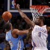 Oklahoma City\'s Serge Ibaka (9) defends Denver\'s Arron Afflalo (6) during the NBA basketball game between the Oklahoma City Thunder and the Denver Nuggets at Chesapeake Energy Arena in Oklahoma City, Wednesday, April 25, 2012. Photo by Bryan Terry, The Oklahoman