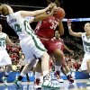 Photo - OU's Abi Olajuwon tries to get around Notre Dame's Erica Williamson as Ashley Barlow , left, and Melissa Lechlitner during the Sweet 16 round of the NCAA women's  basketball tournament in Kansas City, Mo., on Sunday, March 28, 2010. 