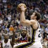 Photo - Utah Jazz's Gordon Hayward, right, goes to the basket as Washington Wizards' Trevor Booker, center, watches during the fourth quarter of an NBA basketball game, Wednesday, Jan. 23, 2013, in Salt Lake City. The Jazz won 92-88. (AP Photo/Rick Bowmer)