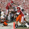 OU\'s DeMarco Murray scores a touchdown in front of OSU\'s Donald Booker, at left, Terrance Anderson and Markelle Martin and OU\'s Jaz Reynolds during the first half of the Bedlam college football game between the University of Oklahoma Sooners (OU) and the Oklahoma State University Cowboys (OSU) at the Gaylord Family-Oklahoma Memorial Stadium on Saturday, Nov. 28, 2009, in Norman, Okla. Photo by Bryan Terry, The Oklahoman