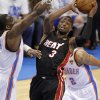 Miami\'s Dwyane Wade (3) shoots over Oklahoma City\'s Kendrick Perkins (5) during Game 2 of the NBA Finals between the Oklahoma City Thunder and the Miami Heat at Chesapeake Energy Arena in Oklahoma City, Thursday, June 14, 2012. Photo by Chris Landsberger, The Oklahoman