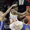 Golden State Warriors\' Andris Biedrins, left, fouls Cleveland Cavaliers\' Alonzo Gee during the first quarter of an NBA basketball game Tuesday, Jan. 29, 2013, in Cleveland. (AP Photo/Mark Duncan)