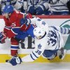 Montreal Canadiens\' Francis Bouillon (55) collides with Toronto Maple Leafs\' Frazer McLaren during the first period of an NHL hockey game in Montreal, Saturday, Feb. 9, 2013. (AP Photo/The Canadian Press, Graham Hughes)