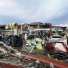 Henryville High School in Henryville, Ind., is destroyed after powerful storms stretching from the U.S. Gulf Coast to the Great Lakes in the north wrecked two small towns and killed at least eight people Friday, March 2, 2012, as the system tore roofs off schools and homes and damaged a maximum security prison. It was the second deadly tornado outbreak this week. (AP Photo/The News and Tribune, C.E. Branham) ORG XMIT: INJEF108