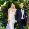 "Photo -   This photo provided by Facebook shows Facebook founder and CEO Mark Zuckerberg and Priscilla Chan at their wedding ceremony in Palo Alto, Calif., Saturday, May 19, 2012. Zuckerberg updated his status to ""married"" on Saturday. The ceremony took place in Zuckerberg's backyard before fewer than 100 guests, who all thought they were there to celebrate Chan's graduation. (AP Photo/Facebook, Allyson Magda Photography)"