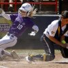 LSU\'s Ashley Applegate scores past California\'s Victoria Jones in the second inning of a Women\'s College World Series game at ASA Hall of Fame Stadium in Oklahoma City, Thursday, May 31, 2012. Photo by Bryan Terry, The Oklahoman