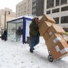 Criag Bond makes a delivery on Court Street in Buffalo, N.Y, Thursday, Jan. 2, 2014. A winter storm promising significant snowfall, strong winds and frigid air bore down Thursday on the Northeast, making commutes hazardous for the first work day of the new year and giving some students an extra day off school following Christmas break. (AP Photo/The Buffalo News, Mark Mulville) TV OUT; MAGS OUT; MANDATORY CREDIT; BATAVIA DAILY NEWS OUT; DUNKIRK OBSERVER OUT; JAMESTOWN POST-JOURNAL OUT; LOCKPORT UNION-SUN JOURNAL OUT; NIAGARA GAZETTE OUT; OLEAN TIMES-HERALD OUT; SALAMANCA PRESS OUT; TONAWANDA NEWS OUT