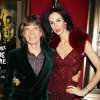 Photo - FILE - This Nov. 13, 2012 file photo released by Starpix shows Mick Jagger of The Rolling Stones, left, and fashion designer L'Wren Scott at the HBO premiere of his film,