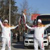 Photo - In this photo taken on Tuesday, Feb. 4, 2014 and provided by Olympictorch2014.com, Olympic torch bearers the Bolshoi Ballet chief Sergei Filin, left, and Andrea Magelli, right, hold  Olympic torches during the torch relay in Krasnodar, the capital city of the Krasnodar region, Russia.  The relay for the Sochi Winter Games, which began on Oct. 7, 2013 in Moscow, will pass through many cities that showcase the historical, cultural and ethnic richness of Russia. (AP Photo/Olympictorch2014.com) EDITORIAL USE ONLY