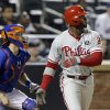 Photo - Philadelphia Phillies' Domonic Brown follows through on an RBI single during the third inning of a baseball game against the New York Mets, Friday, May 9, 2014, in New York. (AP Photo/Frank Franklin II)