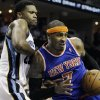 New York Knicks\' Carmelo Anthony (7) pushes past Memphis Grizzlies\' Rudy Gay during the first half of an NBA basketball game in Memphis, Tenn., Friday, Nov. 16, 2012. (AP Photo/Danny Johnston)