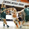 Oklahoma State\'s Brittney Martin (22) tries to get by Cal Poly\'s Ariana Elegado (5) and Kayla Griffin (1) during the women\'s college basketball game between Oklahoma State and Cal Poly at Gallagher-Iba Arena in Stillwater, Okla., Friday, Nov. 9, 2012. Photo by Sarah Phipps, The Oklahoman
