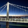 Photo - In a handout photo provided by the Bay Area Toll Authority, LED lights illuminate the San Francisco-Oakland Bay Bridge's  self-anchored suspension on Thursday, Aug. 29, 2013, in San Francisco. With traffic between Oakland and San Francisco halted over Labor Day weekend for construction, bridge officials say the new span will open by Tuesday morning. (AP Photo/Noah Berger)