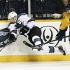 San Jose Sharks defenseman Jason Demers, left, shoots after colliding with Nashville Predators defenseman Ryan Ellis (4) during the first period of an NHL hockey game Tuesday, Feb. 12, 2013, in Nashville, Tenn. (AP Photo/Mark Humphrey)