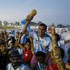 Photo - Argentine soccer fans celebrate, one day before the 2014 Soccer World Cup debut of their team, on Copacabana beach, in Rio de Janeiro, Brazil, Saturday, June 14, 2014. Argentina will play in group F of the tournament. (AP Photo/Leo Correa)