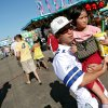Jay Chan, of Oklahoma City, carries his niece Christine Somsack, age 4, through the midway at the 2009 Oklahoma State Fair at State Fair Park in Oklahoma City on Sunday, Sept. 27, 2009. By John Clanton, The Oklahoman ORG XMIT: KOD