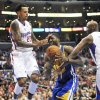 Los Angeles Clippers forward Matt Barnes, left, and forward Lamar Odom, right, defend as Golden State Warriors center Festus Ezeli drives to the basket in the first half of an NBA basketball game in Los Angeles on Saturday, Nov. 3, 2012. (AP Photo/Richard Hartog) ,