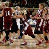 The Pocola team rushes the court as Kelsee Marshall of Walters leaves the court after Pocola\'s win in the Class 2A girls state basketball championship at the State Fair Arena in Oklahoma City, Saturday March 8, 2008. BY BRYAN TERRY, THE OKLAHOMAN