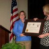 THE ARKANSAS TRAVELER....Ann Bordelon gives Kate Stanton the official governor\'s proclamation. 80 Delta Gammas were on hand for the occasion as well as a surprise guest, Kate\'s mother, Flo Stanton, Bedford, Tx. (Photo provided).