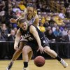 Photo - Idaho forward Brooke Reilly grabs a loose ball in front of Louisville guard Antonita Slaughter, rear, during the first half of an NCAA tournament first-round women's college basketball game, Sunday, March 23, 2014, in Iowa City, Iowa. (AP Photo/Charlie Neibergall)
