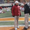 Oklahoma coach Bob Stoops and Oklahoma State coach Mike Gundy talk during the Bedlam college football game between the Oklahoma State University Cowboys (OSU) and the University of Oklahoma Sooners (OU) at Boone Pickens Stadium in Stillwater, Okla., Saturday, Dec. 7, 2013. Photo by Chris Landsberger, The Oklahoman