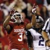 Oklahoma\'s Sterling Shepard (3) reacts after a Sooner touchdown in front of TCU \'s Jason Verrett (2) during the college football game between the University of Oklahoma Sooners (OU) and the Texas Christian University Horned Frogs (TCU) at the Gaylord Family-Oklahoma Memorial Stadium on Saturday, Oct. 5, 2013 in Norman, Okla. Photo by Chris Landsberger, The Oklahoman