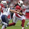 Arizona Cardinals wide receiver Larry Fitzgerald (11) gains yards as St. Louis Rams cornerback Cortland Finnegan (31) defends during the first half of an NFL football game, Sunday, Nov. 25, 2012, in Glendale, Ariz. (AP Photo/Paul Connors)