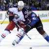 Columbus Blue Jackets center Artem Anisimov (42), from Russia, and Colorado Avalanche left wing Gabriel Landeskog (92), from Sweden, chase a puck during the first period of an NHL hockey game on Thursday, Jan. 24, 2013, in Denver. (AP Photo/Jack Dempsey)