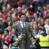 Photo - Open Golf champion Rory McIlroy smiles as he walks down the touchline holding his Claret Jug trophy as he is introduced to the crowd at half time during Manchester United's English Premier League soccer match against Swansea City at Old Trafford Stadium, Manchester, England, Saturday Aug. 16, 2014. (AP Photo/Jon Super)