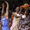 Miami\'s Chris Bosh (1) shoots the ball beside Oklahoma City\'s Thabo Sefolosha (2) during Game 4 of the NBA Finals between the Oklahoma City Thunder and the Miami Heat at American Airlines Arena, Tuesday, June 19, 2012. Oklahoma City lost 104-98. Photo by Bryan Terry, The Oklahoman