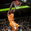 Tennessee\'s Josh Richardson, left, dunks the ball over Missouri\'s Jabari Brown during the second half of an NCAA college basketball game Saturday, Feb. 15, 2014, in Columbia, Mo. Missouri won the game 75-70. (AP Photo/L.G. Patterson)