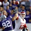 Oklahoma Sooners\' Landry Jones (12) throws the ball past Kansas State Wildcats\' Vai Lutui (92) during the college football game between the University of Oklahoma Sooners (OU) and the Kansas State University Wildcats (KSU) at Bill Snyder Family Stadium on Saturday, Oct. 29, 2011. in Manhattan, Kan. Photo by Chris Landsberger, The Oklahoman ORG XMIT: KOD