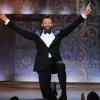 Photo - Host Hugh Jackman performs onstage at the 68th annual Tony Awards at Radio City Music Hall on Sunday, June 8, 2014, in New York. (Photo by Evan Agostini/Invision/AP)