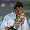 Photo - Spain's Rafael Nadal poses with the trophy after winning the final  against France's Gael Monfils during the ExxonMobil Qatar ATP Open Tennis tournament at the Khalifa Tennis Squash Complex in Doha, Qatar, Saturday, Jan. 4, 2014. (AP Photo/Osama Faisal)