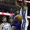 Sacramento Kings\' John Salmons (5) tries to go between Memphis Grizzlies\' Marreese Speights, right, and Marc Gasol (33), of Spain, during the first half of an NBA basketball game in Memphis, Tenn., Friday, Jan. 18, 2013. (AP Photo/Danny Johnston)