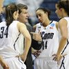 Photo - Connecticut head coach Geno Auriemma, second from left speaks with players Kelly Faris, left, Bria Hartley, second from right, and Caroline Doty, right, during the second half of a first-round game against Idaho in the women's NCAA college basketball tournament in Storrs, Conn., Saturday, March 23, 2013. Connecticut won 105-37. (AP Photo/Jessica Hill)