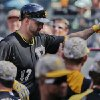 Photo - Pittsburgh Pirates' Gaby Sanchez (17) is greeted by teammates in the dugout after hitting a solo home run against the New York Mets during the eighth inning of a baseball game, Monday, May 26, 2014, in New York. (AP Photo/Julie Jacobson)