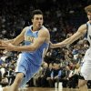 Denver Nuggets\' Danilo Gallinari, left, of Italy, drives around Minnesota Timberwolves\' Andrei Kirilenko, of Russia, in the second half of an NBA basketball game on Wednesday, Nov. 21, 2012, in Minneapolis. The Nuggets won 101-94. Gallinari led his team with 19 points. (AP Photo/Jim Mone)